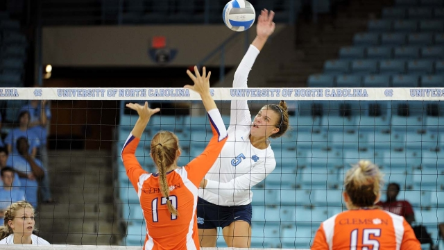 Seaholm graduate Paige Neuenfeldt spikes the ball in a game against Clemson. Neuenfeldt is the middle blocker for the North Carolina volleyball team.  PHOTO / JEFF CAMARATI, UNC ATHLETICS
