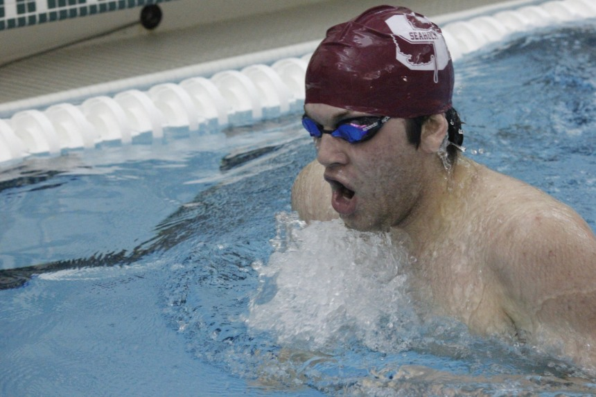Senior Zach Miller swims breaststroke for Seaholm at the Groves meet.  PHOTO / MADELINE TEW