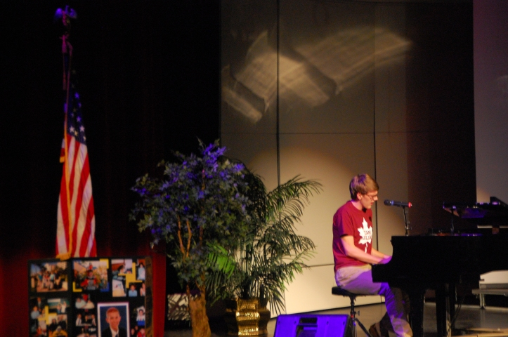 Seaholm senior Eric Smith performs a song in honor of Collin Trask during the Seaholm memorial.  PHOTO / CAROLINE SQUATRITO