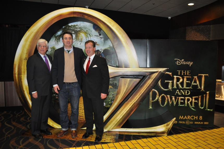 """Chairman and CEO of the Motion Picture Association of America Chris Dodd [left], """"Oz"""" producer Grant Curtis [center], and Senator Richardville [right] pose on the yellow brick road during the Royal Oak premiere of the film.  PHOTO / MOLLY FORCE"""