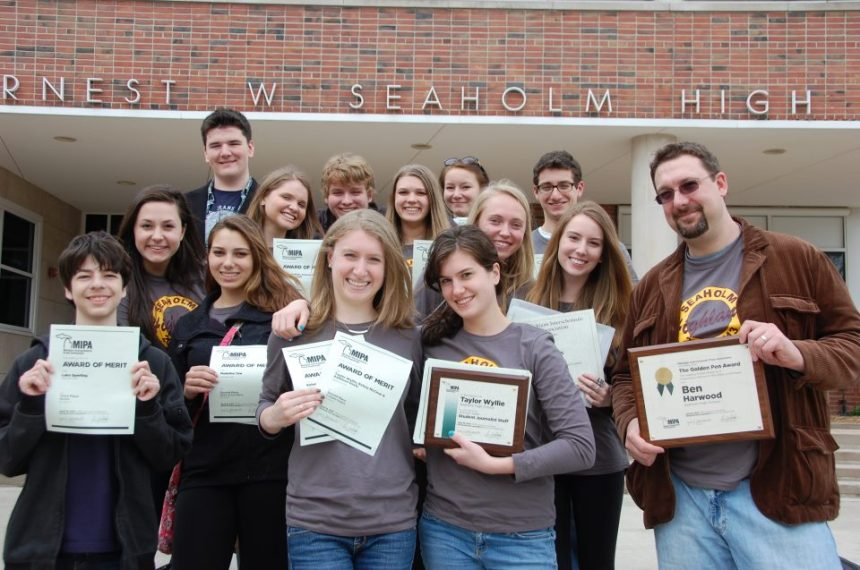 The Highlander staff standing on the steps of Seaholm High School after a successful day at MIPA. From left, front: Luke Sperling, Photo Editor Caroline Squatrito, Editor-in-Chief Kelsey McClear, Managing Editor and MIPA All-State Journalist Taylor Wyllie, Advisor and Golden Pen winner Ben Harwood. From left, middle: Meghan Flynn, News Editor Kendall Hitch, Esther Seawell, Student Life Editor Molly Force, Web Editor Kathleen Davis. From left, back: Graphics Editor Ben Bishop, Community Editor Connor Park, Opinion Editor Kelly Martinek, & Sports Editor David Granadier.