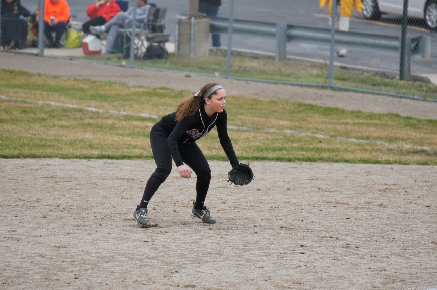 Sophomore and returning varsity player Maddy Cormier readies herself to field a ball hit her way during the team's first home game.  PHOTO / CAROLINE SQUATRITO