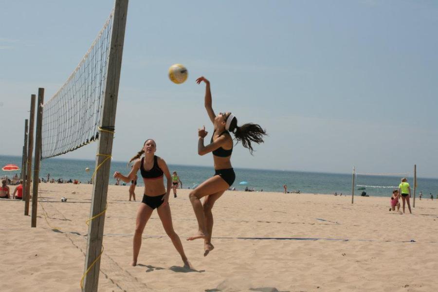 Erin Neuenfeldt plays in a sand volleyball qualifying match in Holland, MI.  PHOTO COURTESY OF ERIN NEUENFELDT