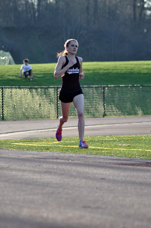 Sophomore Audrey Belf runs in the 1600 for the  Seaholm girls track team during the league meet.  PHOTO / CIE BROWN