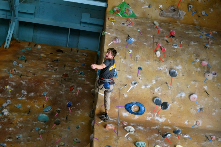 Senior Max Cormier climbs at Miguel's Pizza and Rock Climbing.  PHOTO / MOLLY FORCE