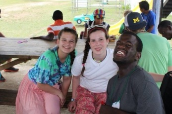 Junior Kelly Teahan pictured with another miss trip volunteer and man in Jamaica disabled home. Photo Courtesy / Kelly Teahan
