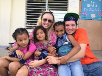 Senior Emily Abbott pictured with another volunteer and children in Belize. Photo Courtesy / Emily Abbott