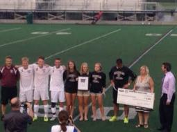 The captains and coaches pose with their check.  Photo / Adam Klepp
