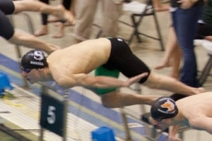 Senior Jack Russell dives into the pool at the 2014 state meet. Russell went on to win the 200 individual medley at states. Photo / Jack Russell