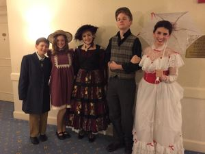 The cast poses for a photo before performing at the Townshend.  Pictured left to right: Jonas Annear (Michael), Freshman Lulu Bushman (Jane), Sophomore Jacqueline Lee (Mrs. Corry), Senior Freddy Hewitt (Bert), and Senior Amanda Najor (Mary Poppins). Photo / Amanda Najor
